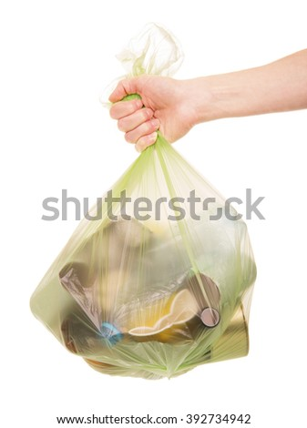Female hand holding a package with household waste isolated on white background. - stock photo