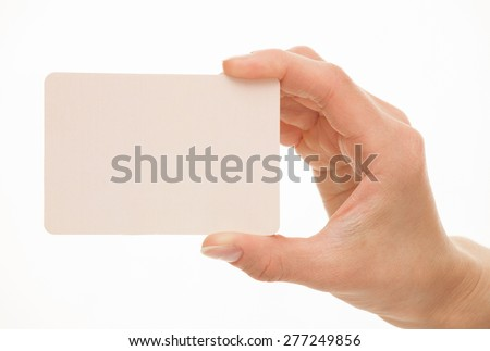 Female hand holding a  paper card, white background - stock photo