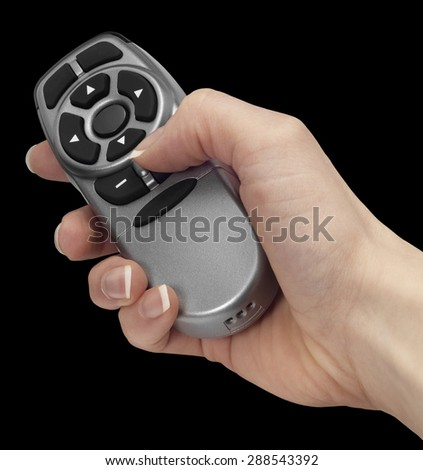 female hand holding a remote control in black back