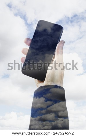 Female hand holding a smart phone surrounded by clouds  - stock photo