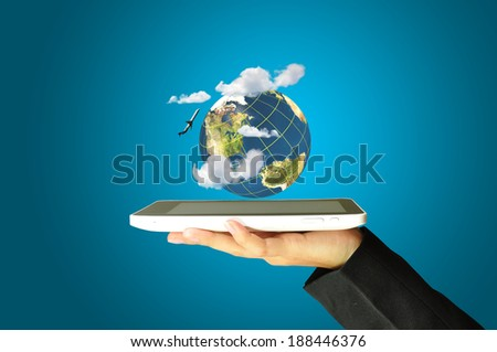 female hand holding a tablet touch computer gadget present earth globe and airplane as transportation concept - stock photo