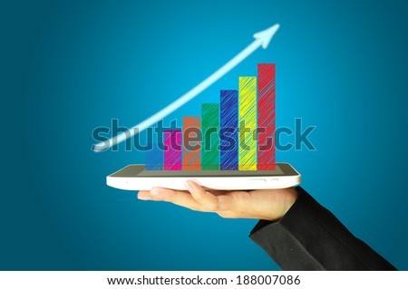 female hand holding a tablet touch computer gadget present graph - stock photo