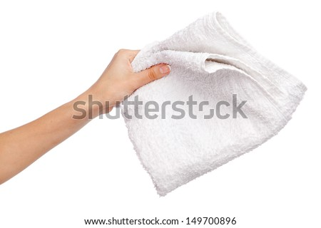 Female hand holding a white towel, isolated on white background - stock photo