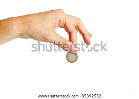 Female hand holding an euro coin - stock photo