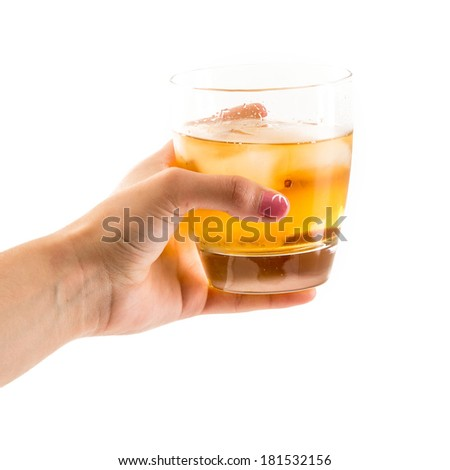 Female hand holding an old fashioned glass with whisky on the rocks served. Image over white background - stock photo