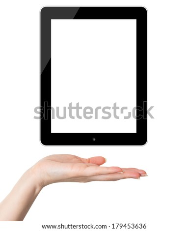 Female hand holding and showing black tablet PC similar to ipade - stock photo