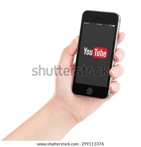 Female hand holding Apple iPhone with YouTube app on the display. YouTube is a video-sharing site allows users to upload, view, and share videos. Isolated on white. Varna, Bulgaria - February 02, 2015 - stock photo
