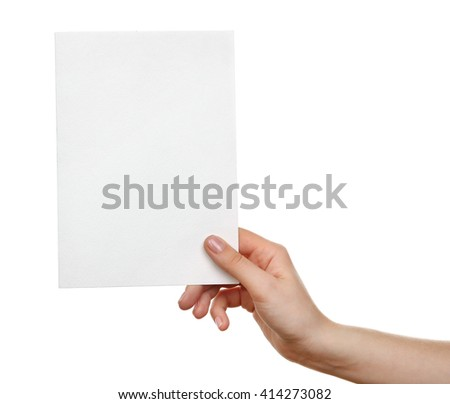 Female hand holding blank sheet of paper isolated on white - stock photo