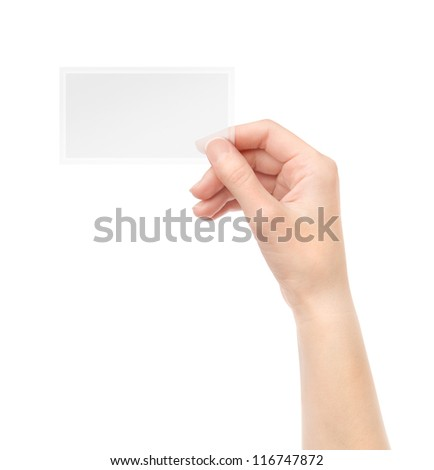 Female hand holding blank transparent business card in hand. Isolated on white. - stock photo