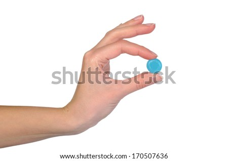 Female hand holding blue tablet isolated on white - stock photo