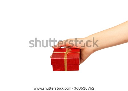 female hand holding red gift box with a gold ribbon isolated on white background - stock photo