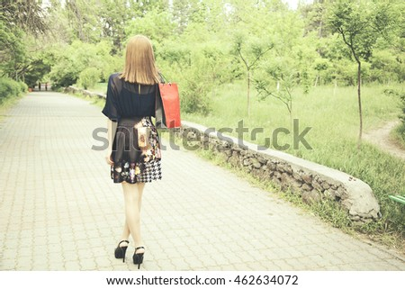 Female hand holding shopping bags outdoors