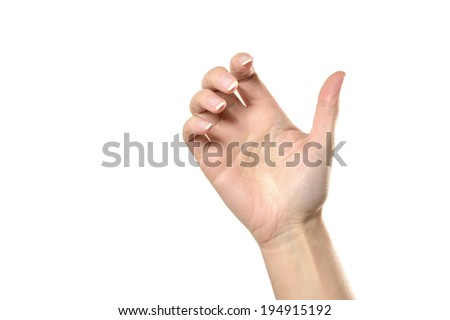 Female hand holding something isolated on white background - stock photo