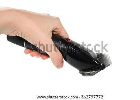 female hand holding the hair clipper on a white background
