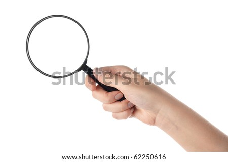 Female hand holding the magnifying glass (isolated) - stock photo