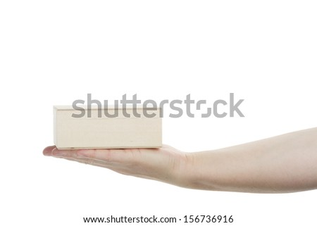 Female hand holding wooden box isolated on white background - stock photo