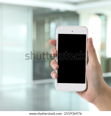 Female hand is holding a modern touch screen smart phone.  - stock photo