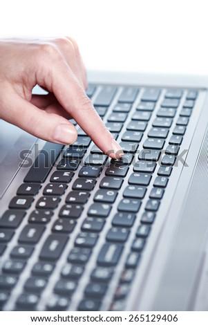 Female hand on laptop keyboard closeup - stock photo