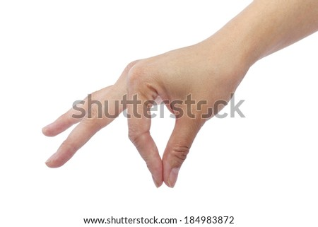 female hand picking up something invisible for composites - stock photo