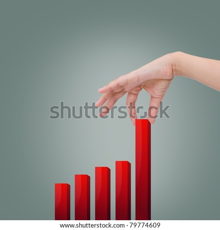 Female hand pulling up a bar from a graph
