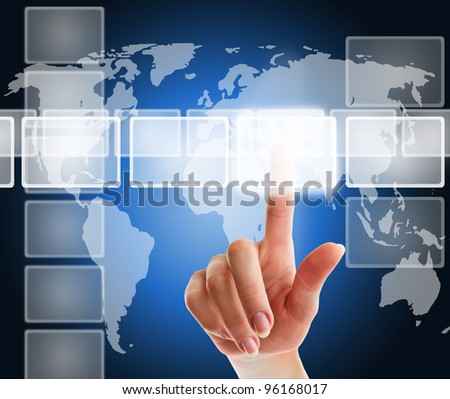 female hand pushing a button on a touch screen interface over blue background with world map - stock photo