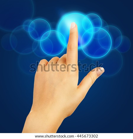 Female hand pushing a button on virtual screen - stock photo