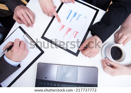 Female hand reading diaphragms during business appointment