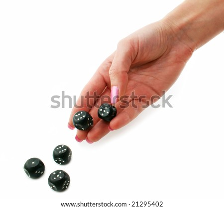 Female hand rolling black dice isolated on a white background - stock photo