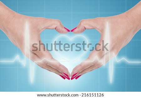 Female hand showing heart shape gesture, ecg line background - stock photo