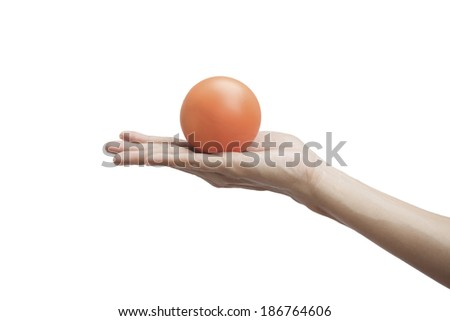 Female hand squeezing an orange stress ball  - stock photo