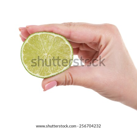 Female hand squeezing lime isolated on white - stock photo