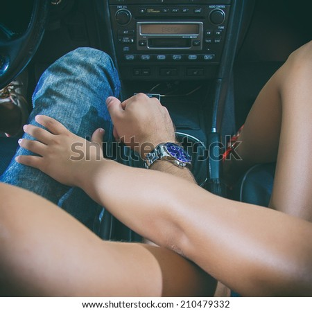 Female hand touches the male knee. - stock photo
