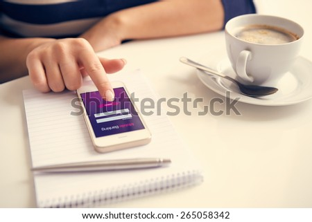 Female hand using mobile banking on white smartphone, toned - stock photo