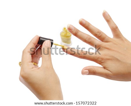 female hand with a golden nail polish on white background  - stock photo
