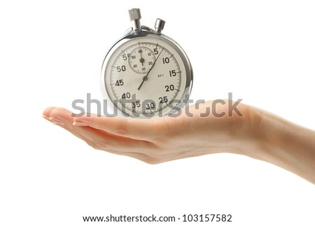 Female hand with a stopwatch - stock photo