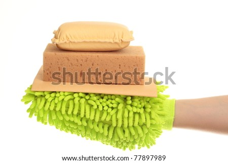 Female hand with a yellow chamois sponge mitt isolated on a white background - stock photo