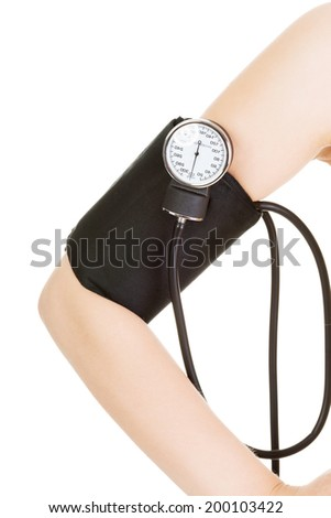 Female hand with blood-pressure meter isolated over white - stock photo