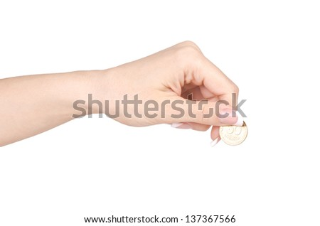 Female hand with coin.