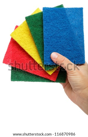 Female hand with colorful cleaning sponges, isolated on a white background. - stock photo