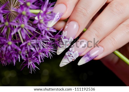 Female hand with fancy manicure - stock photo