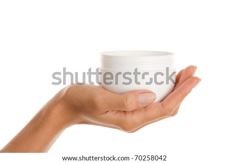 Female hand with jar of body lotion - stock photo
