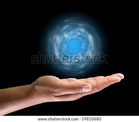Female hand with lighting ball over - stock photo