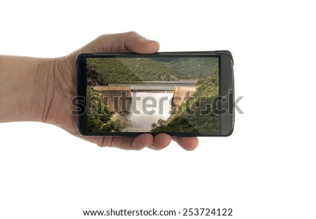 female hand with mobile phone isolated on white swadine waterfall south africa - stock photo