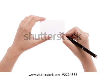 Female hand with pen writing on blank card