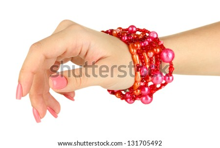 Female hand with pink manicure and bright bracelets, isolated on white - stock photo