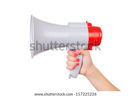 Female hand with pink nails holding a megaphone isolated on a white background - stock photo
