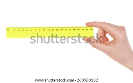 Female hand with plastic ruler isolated on white