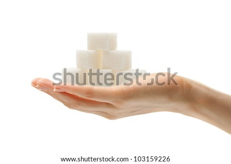 Female hand with sugar cubes - stock photo