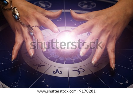 female hands above magic sphere for divination - stock photo