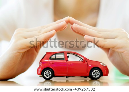 Female hands and car as protection of car concept - stock photo